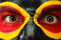 Germany sports fan patriot. Painted country flag on angry man face. Devil Eyes close up Royalty Free Stock Photo