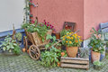Germany, wooden wagon full of flowers Royalty Free Stock Photo