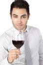 Geschäftsmann holding red wine glas Stockbild