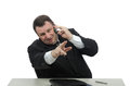 Gesticulating clerk hangs on the cellphone Royalty Free Stock Photography