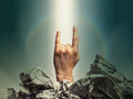 Gesture rock on hand raised showing a heavy metal Stock Image