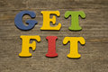 Get fit text on a wooden background Royalty Free Stock Photography
