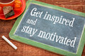 Get inspired and stay motivated motivational teax on a slate blackboard with chalk cup of tea Stock Photos