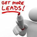 Get more sales leads salesman writing words increase selling written by a with red marker to illustrate the need to find customers Stock Image
