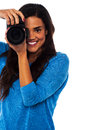 Get ready for a snapshot female photographer at work say cheese Stock Photography