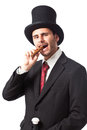 Get rich with me a businessman a cigar wearing a top hat and carryng a walking stick Stock Photos
