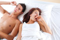 Get up you sleepyhead young couple in bed Stock Photography