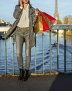 Fashion-monger with shopping bags speaking on mobile in Paris Royalty Free Stock Photo