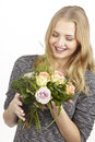 She gets a bouquet of flowers (roses) fpr birthday Royalty Free Stock Photo