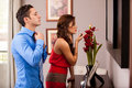 Getting ready for a date young hispanic couple to go out in front of the mirror Royalty Free Stock Image