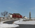 Gettysburg farm red barn and white log house with snow covered field at pennsylvania national park Royalty Free Stock Image