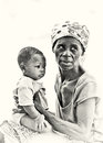 Ghanaian mother and her baby on his hands Stock Images