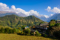 Ghandruk village in the annapurna region and south and hiunchuli background nepal Stock Photography