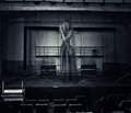 Ghost of actress on stage of old theater halloween horror blured woman was destroyed Stock Photography