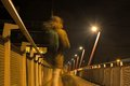 Ghost of a Man and dog on a Pedestrian bridge at night Royalty Free Stock Photo