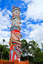 Ghost mask totem pole and blue sky background Royalty Free Stock Photography