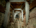 Ghost miner walks his abandoned decaying tunnel searching gold silver riches never found Royalty Free Stock Photography