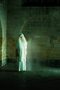 Ghost at night scene in a medieval castle with a woman Royalty Free Stock Images
