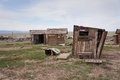Ghost town shacks a group of small wooden in cisco a in utah usa the are in various stages of decay and the ground is Royalty Free Stock Photo