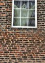 A ghostly figure looking out from an old window Royalty Free Stock Photo