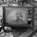 Ghostly figure on vintage tv set Royalty Free Stock Photo