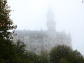 Ghostly scene castle neuschwanstein in fog the famous new swanstone bavaria germany comes on out of the picture taken late Stock Image