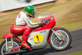 Giacomo agostini fifteen times motorcycle world champion riding his classic mv agusta motorcycle at the festival of speed event at Stock Photography