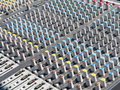 Giant audio sound mixer with color buttons and sliders console Royalty Free Stock Photo