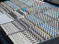 Giant audio sound mixer with color buttons and sliders console Stock Images