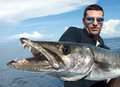 The giant barracuda lucky fisherman holding a Stock Photo