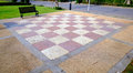 Giant checker board on floor red white concrete in park Stock Image