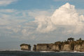 Giant cumulus clouds above cliffs at cape foulwind in new zealand Royalty Free Stock Image