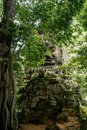 Giant face temple gate around angkor wat temple area Royalty Free Stock Photo