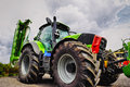 Giant farming tractor, tires and plough Royalty Free Stock Photo