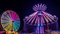 Giant Ferris Wheel and Yo-Yo Amusement ride Royalty Free Stock Photo