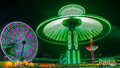 Giant Ferris Wheel and Yo-Yo Amusement ride Royalty Free Stock Photo