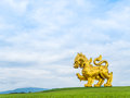 Giant golden lion statue singha park logo chiangrai thailand august side view of the of beer and boonrawd farm on top of hill with Royalty Free Stock Images