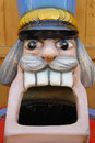 Giant head of nutcracker figure sculpture with wide open mouth closeup screaming big teeth and a nice mustache Royalty Free Stock Images