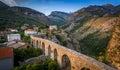 Giant medieval stone bridge in the mountains Royalty Free Stock Photo