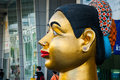 Giant model of a Thai woman's head, near big shopping mall, Bangkok Royalty Free Stock Photo