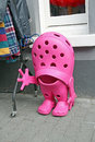 Giant pink croc shoe photo of a rubber with waving hand outside shop nphoto taken st may Royalty Free Stock Images