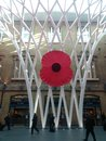 Giant poppy at kings cross station london Royalty Free Stock Photo
