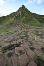 Giant s causeway stones and mountain in northern ireland Stock Image