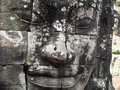 Giant stone face at bayon temple in angkor cambodia ancient siem reap Stock Photo