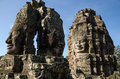 Giant stone faces of Bayon temple in Angkor Thom Royalty Free Stock Photo