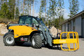 Giant tendo telehandler with bale clamps lieto finland march displayed the advantages of telehandlers compared to forklift and Stock Image