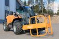 Giant tendo telehandler lieto finland march with clamps on display the advantages of telehandlers compared to forklift and front Stock Photos