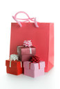 Gift bag with gift boxes and shopping isolated on white background Royalty Free Stock Photo
