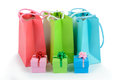 Gift bags and gift boxes multicolor on white background Royalty Free Stock Photos