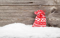 Gift Bags with winter snow on wooden boards Royalty Free Stock Photo